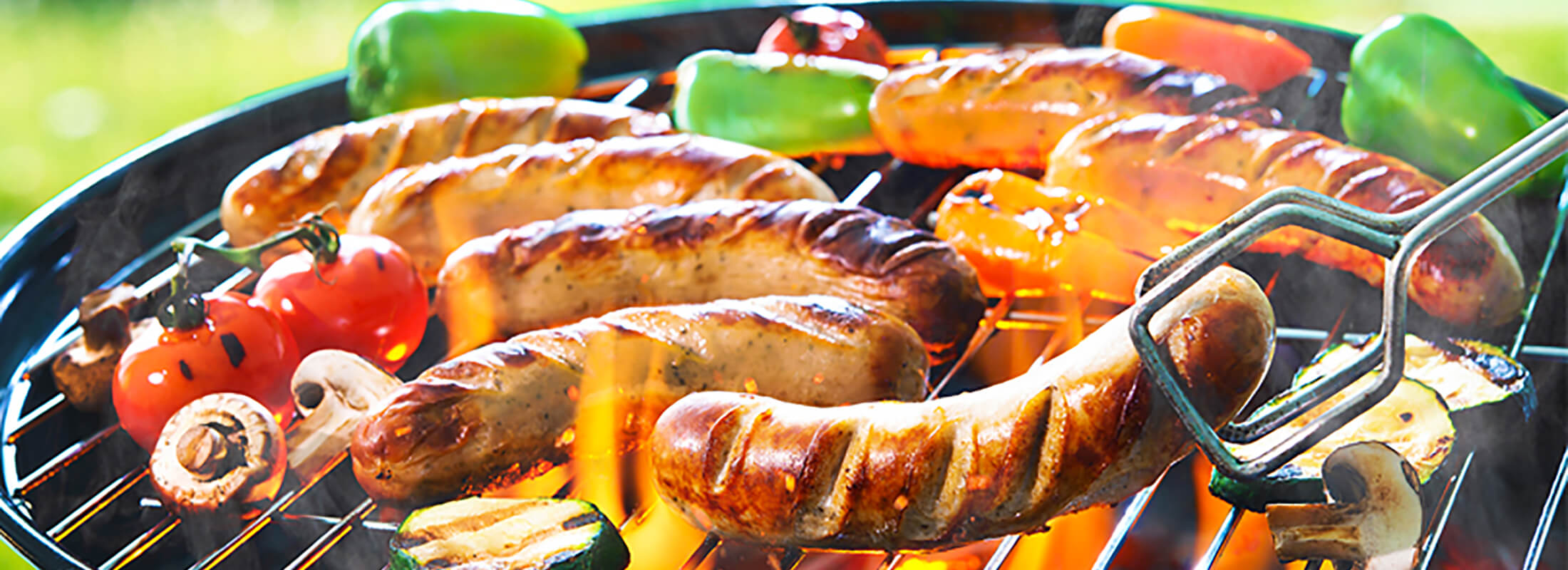 Gluten-free sausages with vegetables on a barbecue